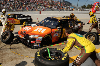 MARTINSVILLE, VA - OCTOBER 24:  Kyle Busch, driver of the #18 M&M's Toyota, pits during the NASCAR Sprint Cup Series TUMS Fast Relief 500 at Martinsville Speedway on October 24, 2010 in Martinsville, Virginia.  (Photo by Rusty Jarrett/Getty Images for NAS