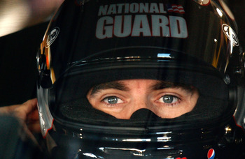 MARTINSVILLE, VA - OCTOBER 23:  Jeff Gordon, driver of the #24 DuPont/National Guard Families Chevrolet, sits in his car during practice for the NASCAR Sprint Cup Series TUMS Fast Relief 500 at Martinsville Speedway on October 23, 2010 in Martinsville, Vi