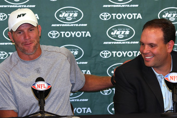 CLEVELAND, OH - AUGUST 7:  Brett Favre of the New York Jets speaks alongside Executive Vice President/General Manager Mike Tannenbaum (R) during a press conference on August 7, 2008 in Cleveland, Ohio. The press conference was held prior to a preseason ga