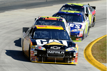 MARTINSVILLE, VA - OCTOBER 24:  Jeff Burton, driver of the #31 Caterpilliar Chevrolet, leads Greg Biffle, driver of the #16 3M Ford, Jimmie Johnson, driver of the #48 Lowe's Chevrolet, and Jeff Gordon, driver of the #24 DuPont/National Guard Families Chev
