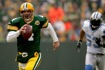 GREEN BAY, WI - DECEMBER 30: Quarterback Brett Favre #4 of the Green Bay Packers is chased out of the pocket by Paris Lenon #53 of the Detroit Lions December 30, 2007 at Lambeau Field in Green Bay, Wisconsin.  (Photo by Matthew Stockman/Getty Images)