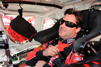 MARTINSVILLE, VA - OCTOBER 24:  Tony Stewart, driver of the #14 Old Spice/Office Depot Chevrolet, sits in his car prior to the start of the NASCAR Sprint Cup Series TUMS Fast Relief 500 at Martinsville Speedway on October 24, 2010 in Martinsville, Virgini