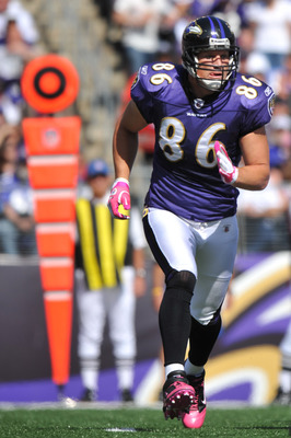 BALTIMORE, MD - OCTOBER 10: Todd Heap #86 of the Baltimore Ravens runs in the backfield during the game against the Denver Broncos at M&T Bank Stadium on October 10, 2010 in Baltimore, Maryland. Players wore pink in recognition of Breast Cancer Awareness