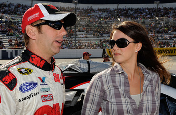 MARTINSVILLE, VA - OCTOBER 24:  Greg Biffle (L), driver of the #16 3M Ford, stands on the grid with his wife Nicole prior to the during the NASCAR Sprint Cup Series TUMS Fast Relief 500 at Martinsville Speedway on October 24, 2010 in Martinsville, Virgini