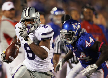 LAWRENCE, KS - OCTOBER 14:  Daniel Thomas #8 of the Kansas State Wildcats carries the ball as Olaitan Oguntodu #44 of the Kansas Jayhawks defends during the game on October 14, 2010 at Memorial Stadium in Lawrence, Kansas.  (Photo by Jamie Squire/Getty Im