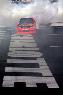 CONCORD, NC - OCTOBER 16:  Jamie McMurray, driver of the #1 Bass Pro Shops/Tracker Boats Chevrolet, does a burnout after winning the NASCAR Sprint Cup Series Bank of America 500 at Charlotte Motor Speedway on October 16, 2010 in Concord, North Carolina.