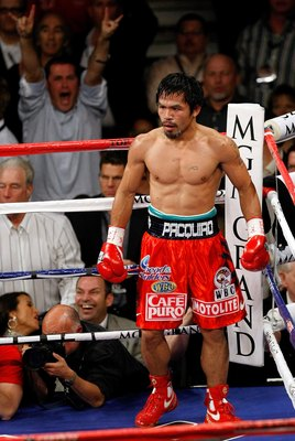 LAS VEGAS - NOVEMBER 14:  Manny Pacquiao stands in a neutral corner after knocking Miguel Cotto down in the third round during their WBO welterweight title fight at the MGM Grand Garden Arena on November 14, 2009 in Las Vegas, Nevada. Pacquiao defeated Co