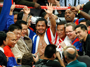 LAS VEGAS - DECEMBER 06:  Manny Pacquiao of the Philippines and his team celebrate his victory over Oscar De La Hoya in their welterweight bout at the MGM Grand Garden Arena December 6, 2008 in Las Vegas, Nevada.  (Photo by Ethan Miller/Getty Images)