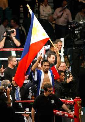 LAS VEGAS - DECEMBER 06:  Manny Pacquiao waves the flag of the Philippines in the ring as he celebrates his victory over Oscar De La Hoya in their welterweight bout at the MGM Grand Garden Arena December 6, 2008 in Las Vegas, Nevada.  (Photo by Ethan Mill
