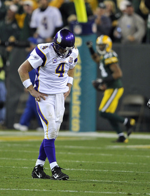 GREEN BAY, WI - OCTOBER 24:  Brett Favre #4 of the Minnesota Vikings reacts as Desmond Bishop #55 of the Green Bay Packers celebrates his interception for a touchdown at Lambeau Field on October 24, 2010 in Green Bay, Wisconsin. (Photo by Jim Prisching/Ge