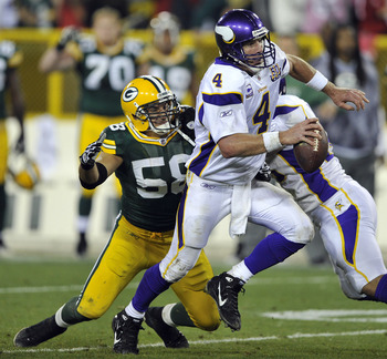 GREEN BAY, WI - OCTOBER 24:  Brett Favre #4 of the Minnesota Vikings scrambles away from Frank Zombo #58 of the Green Bay Packers at Lambeau Field on October 24, 2010 in Green Bay, Wisconsin.  The Packers defeated the Vikings 28-24. (Photo by Jim Prischin