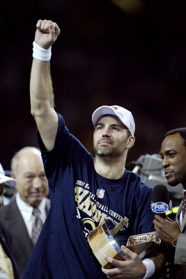 27 Jan 2002:  Quarterback Kurt Warner #13 of the St.Louis Rams holds the George Hallas Trophy after the NFC Championship Game against the Philadelphia Eagles  at the Dome at America's Center in St. Louis, Missouri. The Rams beat the  Eagles 29-24 to advan