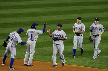 NEW YORK - OCTOBER 18:  (L-R) Ian Kinsler #5, Elvis Andrus #1, Nelson Cruz #17, David Murphy #7 and Josh Hamilton #32 of the Texas Rangers celebrate after the Rangers won 8-0 against the New York Yankees in Game Three of the ALCS during the 2010 MLB Playo