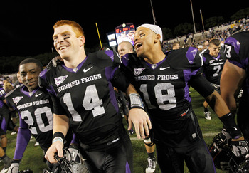 FORT WORTH, TX - OCTOBER 23:  Quarterback Andy Dalton #14 of the TCU Horned Frogs celebrates with cornerback Travaras Battle #18 after TCU beat the Air Force Falcons 38-7 at Amon G. Carter Stadium on October 23, 2010 in Fort Worth, Texas.  (Photo by Tom P