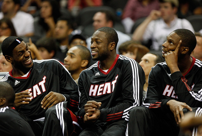 SAN ANTONIO - OCTOBER 09:  LeBron James #6, Dwayne Wade #3, and Chris Bosh #1 of the Miami Heat sit on the bench during the game against the San Antonio Spurs at the AT&T Center on October 9, 2010 in San Antonio, Texas.  NOTE TO USER: User expressly ackno