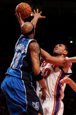 NEW YORK - JANUARY 24:  Jared Jeffries #20 of the New York Knicks shoots over James Singleton #33 of the Dallas Mavericks at Madison Square Garden January 24, 2010 in New York City. NOTE TO USER: User expressly acknowledges and agrees that, by downloading