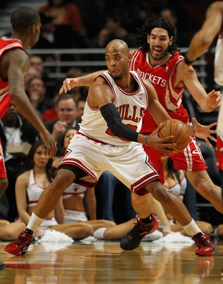 CHICAGO - MARCH 22: Taj Gibson #22 of the Chicago Bulls moves past Luis Scola #4 of the Houston Rockets at the United Center on March 22, 2010 in Chicago, Illinois. The Bulls defeated the Rockets 98-88. NOTE TO USER: User expressly acknowledges and agrees