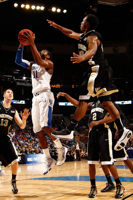 NEW ORLEANS - MARCH 20:  John Wall #11 of the Wake Forest Demon Deacons shoots the ball over Ishmael Smith #10 of the Kentucky Wildcats during the second round of the 2010 NCAA men's basketball tournament at the New Orleans Arena on March 20, 2010 in New