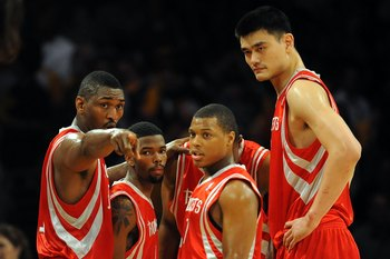 LOS ANGELES, CA - MAY 06:  (L-R) Ron Artest #96, Aaron Brooks #0, Kyle Lowry #7 and Yao Ming #11 of the Houston Rockets huddle against the Los Angeles Lakers in Game Two of the Western Conference Semifinals during the 2009 NBA Playoffs at Staples Center o