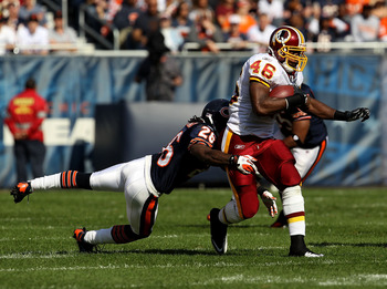 CHICAGO - OCTOBER 24: Ryan Torain #46 of the Washington Redskins runs past Tim Jennings #26 of the Chicago Bears at Soldier Field on October 24, 2010 in Chicago, Illinois. The Redskins defeated the Bears 17-14. (Photo by Jonathan Daniel/Getty Images)