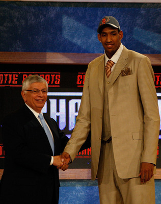 NEW YORK - JUNE 26:  NBA Commissioner David Stern shakes hands with number twenty draft pick for the Charlotte Bobcats, Alexis Ajinca during the 2008 NBA Draft at the Wamu Theatre at Madison Square Garden June 26, 2008 in New York City. NOTE TO USER: User