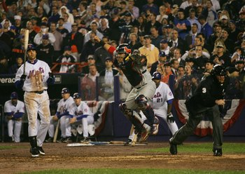 NEW YORK - OCTOBER 19:  Catcher Yadier Molina #4 of the St. Louis Cardinals reacts after Carlos Beltran #15 of the New York Mets stikes out to end game seven of the NLCS at Shea Stadium on October 19, 2006 in the Flushing neighborhood of the Queens boroug