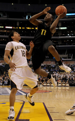 LOS ANGELES, CA - MARCH 11:  Malcolm Armstead #11 of the Oregon ducks shoots over Brandon Smith #12 of the Cal Golden Bears in the second half during the Quarterfinals of the Pac-10 Basketball Tournament at Staples Center on March 11, 2010 in Los Angeles,