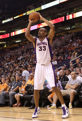 PHOENIX - OCTOBER 19:  Grant Hill #33 of the Phoenix Suns puts up a shot against the Golden State Warriors during the preseason NBA game at US Airways Center on October 19, 2010 in Phoenix, Arizona. NOTE TO USER: User expressly acknowledges and agrees tha