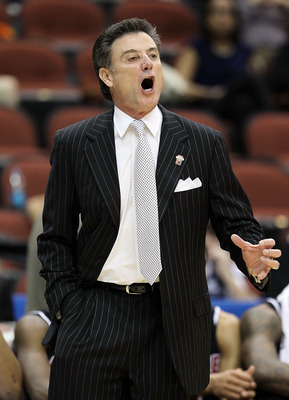 JACKSONVILLE, FL - MARCH 19: Rick Pitino the Head Coach of the Louisville Cardinals gives instructions to his team in the game against the California Golden Bears during the first round of the 2010 NCAA men's basketball tournament at Jacksonville Veteran'