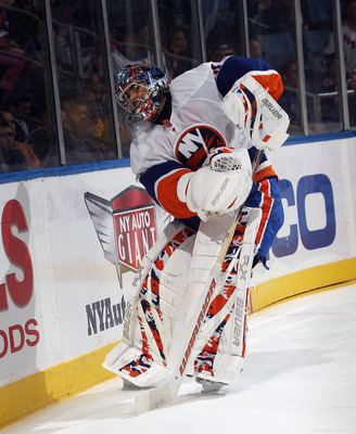 UNIONDALE, NY - OCTOBER 11:  Rick DiPietro #39 of the New York Islanders tends net against the New York Rangers at the Nassau Coliseum on October 11, 2010 in Uniondale, New York.  (Photo by Bruce Bennett/Getty Images)