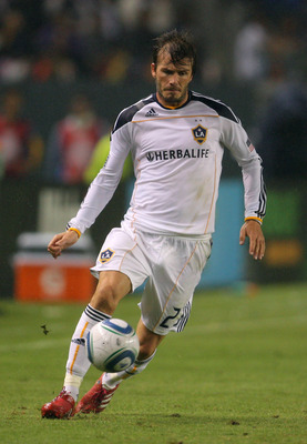 CARSON, CA - OCTOBER 24:  David Beckham #23 of the Los Angeles Galaxy controls the ball on the right wing during the MLS match against FC Dallas on October 24, 2010 in Carson, California. The Galaxy defeated FC Dallas 2-1.  (Photo by Victor Decolongon/Get