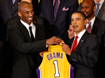 WASHINGTON - JANUARY 25:  Los Angeles Lakers guard Kobe Bryant (L) presents a jersey to President Barack Obama (R) during an event with the National Basketball Association 2009 champions in the East Room of the White House January 25, 2010 in Washington,