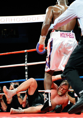 LAS VEGAS - APRIL 10:  Francois Botha falls to the canvas after being hit by Evander Holyfield in the eighth round of their heavyweight bout shortly before Holyfield won by TKO at the Thomas & Mack Center April 10, 2010 in Las Vegas, Nevada.  (Photo by Et