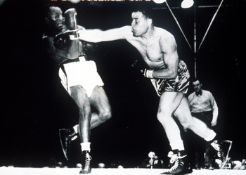 27 Jun 1948 :  Joe Louis beats Jersey Joe Walcott in  the 11th round by KO at Yankee Stadium. Credit :  Allsport. Mandatory Credit: Allsport UK/ALLSPORT