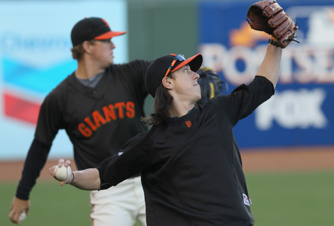 SAN FRANCISCO - OCTOBER 25:  Tim Lincecum #55 of the San Francisco Giants throws alongside teammate Matt Cain #18 during a team workout at AT&T Park on October 25, 2010 in San Francisco, California. The Giants are preparing to face the Texas Rangers in th