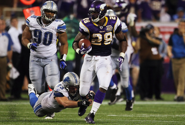 MINNEAPOLIS - SEPTEMBER 26:  Running back Adrian Peterson #28 of the Minnesota Vikings breaks a tackle from Kyle Vanden Bosch #93 of the Detroit Lions at Mall of America Field on September 26, 2010 in Minneapolis, Minnesota. The Vikings defeated the Lions