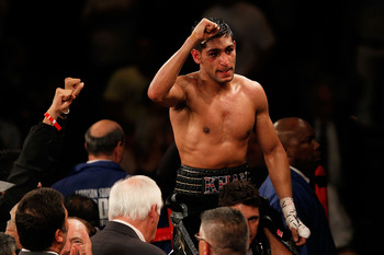 NEW YORK - MAY 15:  Amir Khan of Great Britain celebrates after defeating Paulie Malignaggi by TKO in the 11th round of his WBA light welterweight title fight at Madison Square Garden on May 15, 2010 in New York City.  (Photo by Chris Trotman/Getty Images