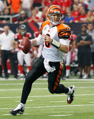 ATLANTA - OCTOBER 24:  Quarterback Carson Palmer #9 of the Cincinnati Bengals rushes out of the pocket against the Atlanta Falcons at Georgia Dome on October 24, 2010 in Atlanta, Georgia.  (Photo by Kevin C. Cox/Getty Images)
