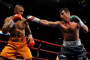 NEW YORK - NOVEMBER 08:  Joe Calzaghe (R) punches Roy Jones Jr (L) during their Ring Magazine Light Heavyweight Championship bout at Madison Square Garden November 8, 2008 in New York City.  (Photo by Al Bello/Getty Images)