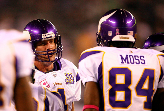 EAST RUTHERFORD, NJ - OCTOBER 11:  Quarterback Brett Favre #4 of the Minnesota Vikings talks with Randy Moss #84 in the huddle during warm ups against the New York Jets at New Meadowlands Stadium on October 11, 2010 in East Rutherford, New Jersey.  (Photo