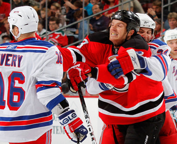 NEWARK, NJ - SEPTEMBER 25: Sean Avery #6 of the New York Rangers gets lunged at by David Clarkson of the New Jersey Devils during a fight in a preseason hockey game at the Prudential Center on September 25, 2010 in Newark, New Jersey.  (Photo by Paul Bere