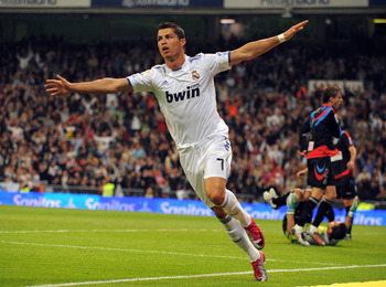 MADRID, SPAIN - OCTOBER 23:  Cristiano Ronaldo of Real Madrid celebrates after scoring Real's second goal during the La Liga match between Real Madrid and Racing Santander at Estadio Santiago Bernabeu on October 23, 2010 in Madrid, Spain.  (Photo by Denis