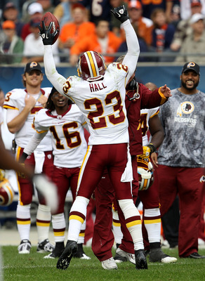 CHICAGO - OCTOBER 24: DeAngelo Hall #23 of the Washington Redskins celebrates an interception in the final minutes of a game against the Chicago Bears at Soldier Field on October 24, 2010 in Chicago, Illinois. The Redskins defeated the Bears 17-14. (Photo