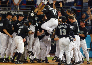 Alex Gonzalez leaps onto home plate after winning Game 4 of the 2003 World Series with a HR
