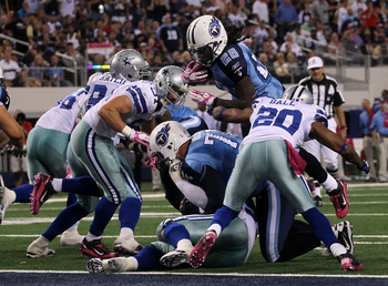 ARLINGTON, TX - OCTOBER 10:  Running back Chris Johnson #28 of the Tennessee Titans dives over the line to score the winning touchdown in the fourth quarter against the Dallas Cowboys at Cowboys Stadium on October 10, 2010 in Arlington, Texas.   The Titan