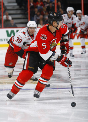 OTTAWA, ON - OCTOBER 14:  Brian Lee #5 of the Ottawa Senators chases after a loose puck during a game against the Carolina Hurricanes at Scotiabank Place on October 14, 2010 in Ottawa, Ontario, Canada.  The Ottawa Senators defeated the Carolina Hurricanes