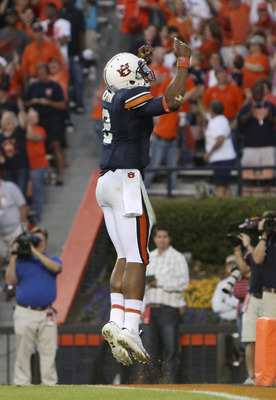 AUBURN - OCTOBER 16:  Quarterback Cam Newton #2 of the Auburn Tigers celebrates a fourth quarter touchdown during the game against the Arkansas Razorbacks at Jordan-Hare Stadium on October 16, 2010 in Auburn, Alabama.  The Tigers beat the Razorbacks 65-43