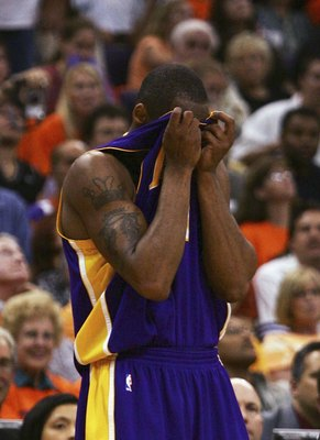 PHOENIX - MAY 2:  Kobe Bryant #8 of the Los Angeles Lakers reacts to a foul against the Phoenix Suns during the fourth quarter in Game 5 of the Western Conference Quarterfinals during the 2006 NBA Playoffs at the US Airways Center on May 2, 2006 in Phoeni