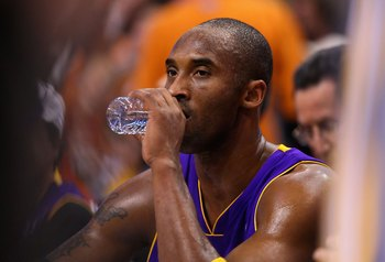 PHOENIX - DECEMBER 28:  Kobe Bryant #24 of the Los Angeles Lakers drinks water on the bench during the NBA game against the Phoenix Suns at US Airways Center on December 28, 2009 in Phoenix, Arizona.  The Suns defeated the Lakers 118-103. NOTE TO USER: Us