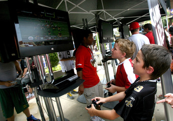 NEW ORLEANS - AUGUST 09:  Fans play Madden NFL 11 at Madden Gras. The event celebrated the launch of EA SPORTS' Madden NFL 11 video game on August 9, 2010 in New Orleans, Louisiana. The game featuring New Orleans Saints quarterback Drew Brees goes on sale